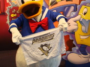 DONALD DUCK SUPPORTS HIS PENGUIN FAMILY