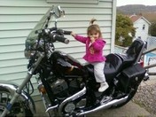 gianna vescio on paps bike