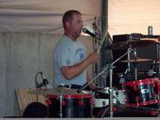Shawn McKenzie, of the band ROCK BOTTOM, playing at the Summer Conert on the Com