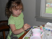 Khiara painting a present for mommy