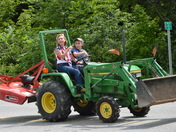 Farmers on tractor