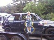 my son in front of his paps racecar