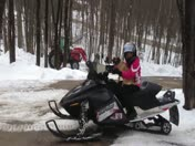 Our puggle love sto snowmobile