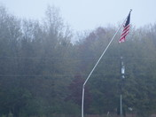 Bent flag pole in cross hill.JPG