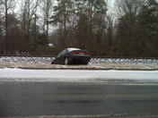 Car in ditch Rutherford Street