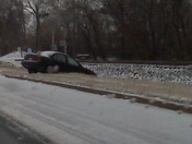Green Car in Ditch Rutherford Street