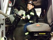 Greyson the Firefighter in a fire truck