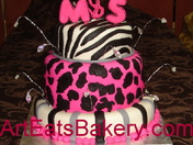 Pink and black fondant animal print birthday cake.jpg