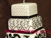 Black and off white square wedding cake