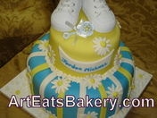 Yellow and blue baby shower cake with fondant dasies