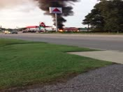 Jeep on fire at gas station