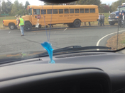 school bus rear ended by dump truck
