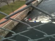 two guys in the Merrimack under the bridge st bridge