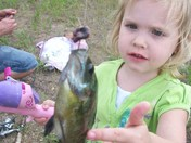 Madison with her first fish of the season