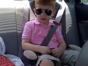 Landon riding in car with sun glasses