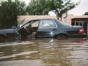 car in flood on Lewis & Clark