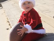 Santa's got a football for some good little girl or boy