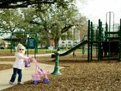Pushing baby at the park