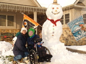 Aaron, Mom, and the 8.5 ft Snowman