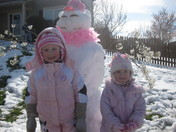 Savannah and Charlotte's snowgirl with pink boa