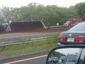Mulch truck turned over on 128 this AM