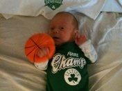 Baby cheers for the Celtics
