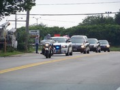 Funeral procession for fallen local hero