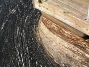 Oil sludge buildup at end of ramp.