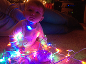 Olivia helping with the lights