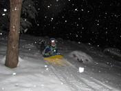 sledding in freshly fallen snow
