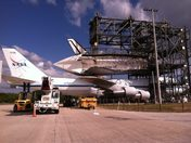 Space Shuttle Discovery preparing to leave KSC