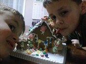 boys trying to eat gingerbread house
