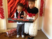 Brother playing keyboard while sister sings