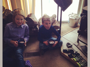 Olivia and Cody Sams warming up by the woodstove. Yay for snow days!