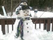 Snowmen piggy-backing
