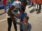 Cassandra Welchlin being greeted by two of children after crossing the Finish li