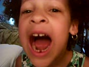 Gabby losing her first tooth