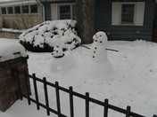Snowman walking his dog 1