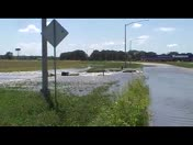 Water rushing over roadway