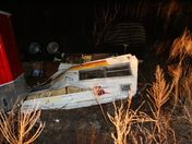 another camper and Ice fishing hut blown over
