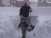Shoveling snow outside of front door.