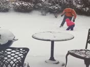 Nancy Nelson (3 yrs) pegging Daddy with a snow ball
