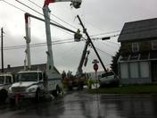 Ppl removing damaged pole