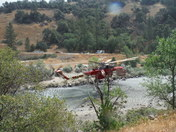 Helicopter fighting fire in El Portal. 7-27-14