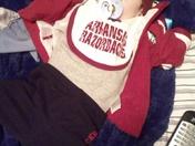 Sports fanatic baby. Go HOGS!!