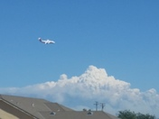 one of the planes fighting the king fire in the background on a landing approach