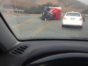 overturned truck on 25 and 101