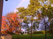 Autumn rainbow and sunset