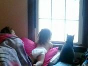 23 mo old jasmine and her 10 yr old cat puddles watching the snow fall