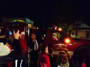 Santa arriving in a fire truck